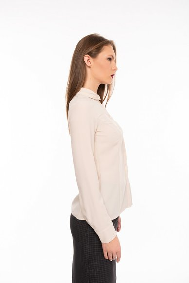 Blouse of beige color
