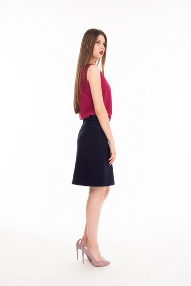 Skirt is dark blue, classic